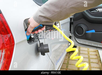 recharge an electric car - Stock Photo