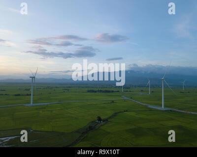Wind turbine farm or windmill on blue sky. Turbine green energy electricity or wind turbine in a green field - Energy Production
