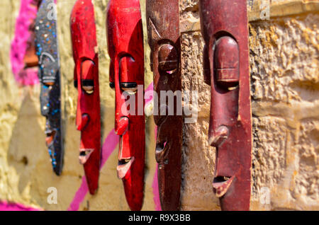 Elongated wooden masks on display and sale in a street shop inside Golden Jaisalmer Fort in Jaisalmer, Rajasthan, India. - Stock Photo