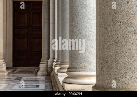 Row of column in colonnade. Classical style colonnade in Rome, Italy - Stock Photo