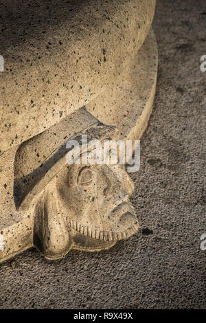 Stone Scandinavian head and face sculpture on outdoor seating, Stockholm, Sweden - Stock Photo