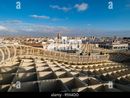 The Metropol Parasol in the old historic quarter of Seville, Spain, is a large wooden mushroom shaped structure popular with tourists to the city.