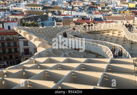 The Metropol Parasol in the old historic quarter of Seville, Spain, is a large wooden mushroom shaped structure popular with tourists to the city. - Stock Photo