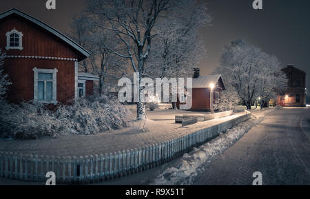 Public park with cozy cafe place and snow covered trees at winter evening in Finland. Cafe place is open only in summertime. - Stock Photo