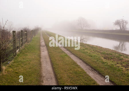 Foggy canal and farm track background - Stock Photo