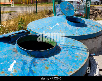 Site for household waste with large metal containers - Stock Photo