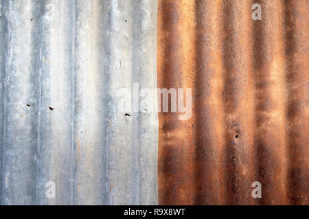 Close up old  rusty galvanized zinc sheet background. - Stock Photo
