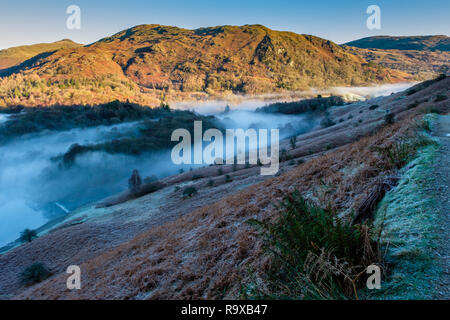 Low mist running through Banneriggs, between Grasmere and Rydal Water, near Grasmere, Lake District, Cumbria - Stock Photo