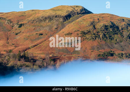 Silver How above a misty lake at Grasmere, Lake District, Cumbria - Stock Photo