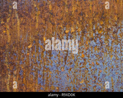 background of metal blue yellow brown rusty plate - Stock Photo