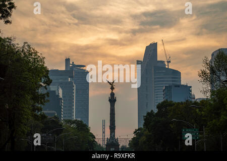 A view of the Angel of Independence on Reforma at sunset in Mexico City, Mexico - Stock Photo