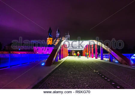 Poznan, Poland - December 26, 2018: The Jordan bridge with decorational lamps during the Christmas holidays by night. - Stock Photo