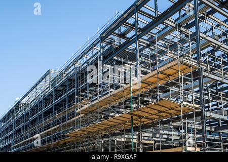 Scaffolding platform on a steel girder framework for a new building on a construction site, Nottingham, England, UK - Stock Photo