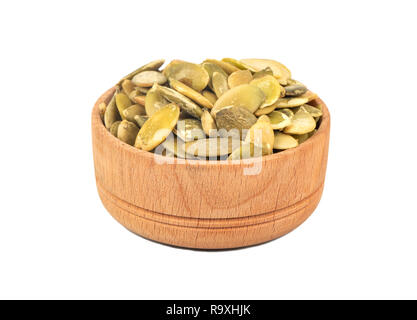 Pumpkin seed kernels in bowl on white background - Stock Photo