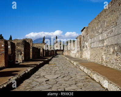 Italy. Pompeii. Ancient Roman city destroyed by the eruption of the Vesuvius in 79 CE. View of Mercurio Street. Via di Mercurio is a short yet primary street running north to south in the northwestern section of the city. La Campania. - Stock Photo