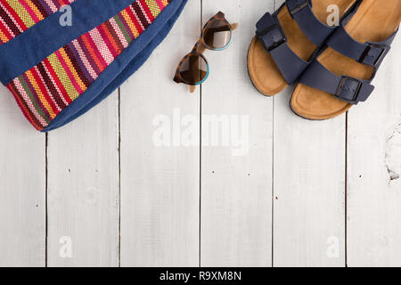 Travel concept - summer women's fashion with bag, sunglasses and sandals - Stock Photo