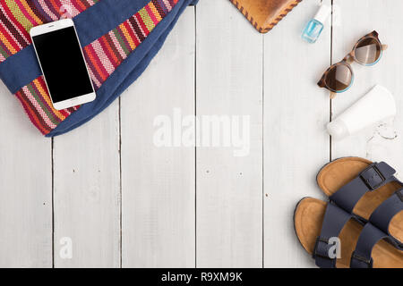 Travel concept - summer women's fashion with bag, phone, sunglasses and sandals - Stock Photo
