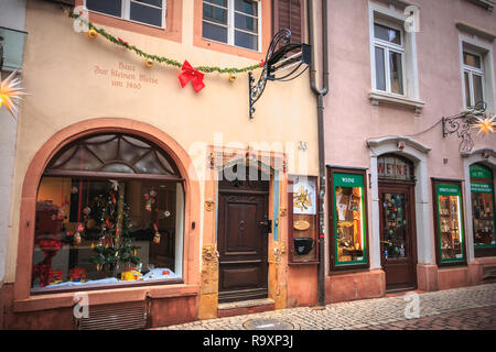 Freiburg im Breisgau, Germany - December 31, 2017: small shops in the historic city center on a winter day - Stock Photo