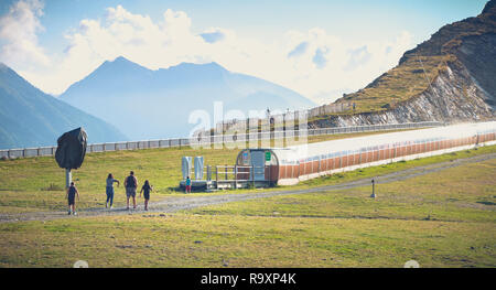 Saint Lary Soulan, France - August 20, 2018: family who walks on the ski slopes of a resort without snow in summer - Stock Photo