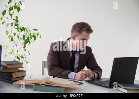 a man works in the Office at the computer business clerk  - Stock Photo