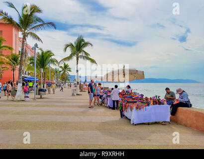 PUERTO VALLARTA, MEXICO - JANUARY 30, 2018 - Tourists walking and shopping on Malecon, the promenade by the ocean, in Puerto Vallarta, Mexico. - Stock Photo
