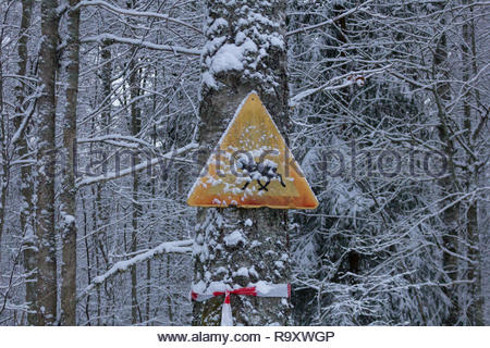 warning sign for crossing moose covered with snow - Stock Photo