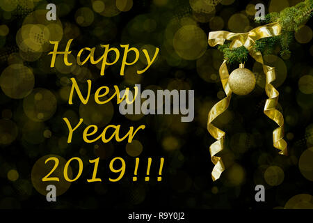 Fir tree branch with a golden glitter ball and ribbon on black background. Bokeh effects. Christmastime. Happy New year greeting postcard. - Stock Photo