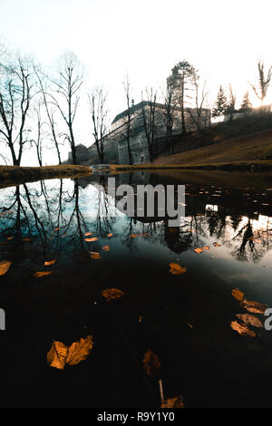 sunrise impression of Castle Forchtenstein (Burgenland, Austria) during winter in a reflecting lake - Stock Photo