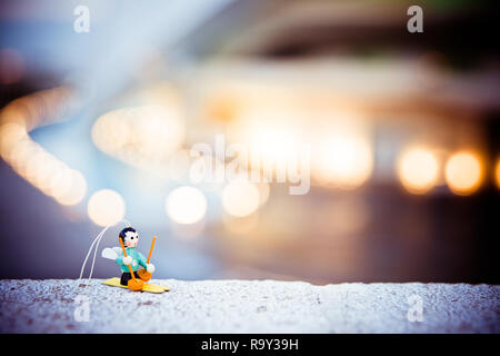 Skier doll to decorate a Christmas tree, with unfocused background. - Stock Photo