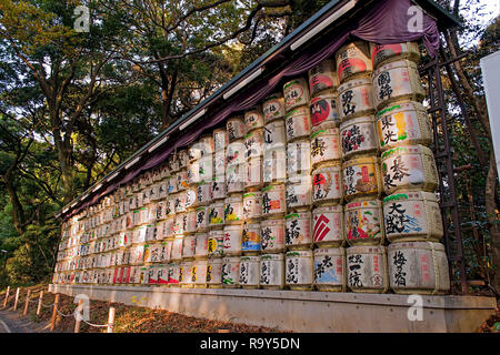 Barrels of sake wrapped in straw at the area of Meiji Jingu, Tokyo Japan - Stock Photo