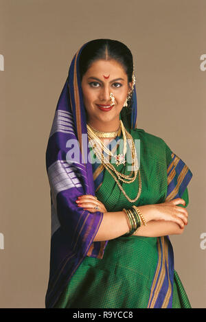 A PORTRAIT OF A MARATHI/MAHARASHTRIAN Bride dressed in traditional SAREE - Stock Photo