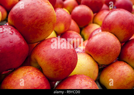 A stack of red apples with front apples in focus and back apples soft focus. As displayed as street food in Bangkok, Thailand. - Stock Photo
