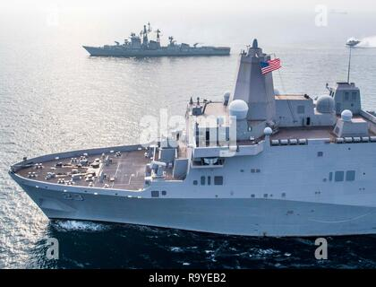 Indian navy destroyer INS Rajput, top, sails alongside the U.S. Navy San Antonio-class amphibious transport dock ship USS Anchorage during cooperative exercises with the December 26, 2018 in the Indian Ocean. - Stock Photo