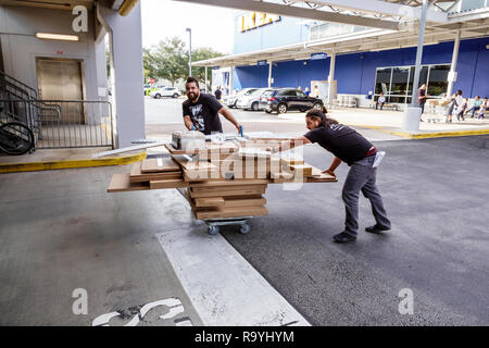 Fort Ft. Lauderdale Florida Sunrise IKEA furniture home furnishings accessories inside shopping man cart purchase - Stock Photo