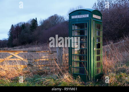 A K6 public pay phone painted in Green , which are normally painted Red. - Stock Photo