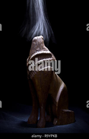 Wooden Wolf Statue with Smoke - Stock Photo