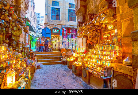 CAIRO, EGYPT - DECEMBER 20, 2017: Bab al-Ghuri gates houses famous lighting shop with variety of bright arabian lanterns and metal lamps,  on December - Stock Photo