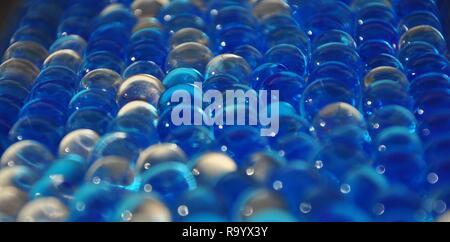 Balls of blue hydrogel. Crystal liquid ball with reflection.Water blue gel balls. Polymer gel. Silica gel. - Stock Photo