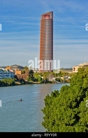 SEVILLE SPAIN THE SEVILLA OR CAJASOL TOWER ON THE BANKS OF THE GUADALQUIVIR RIVER - Stock Photo