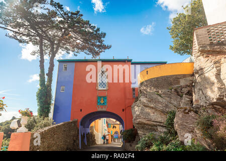 Main gate into popular tourist resort of Portmeirion with it's Italian village style architecture in Gwynedd, North Wales. - Stock Photo