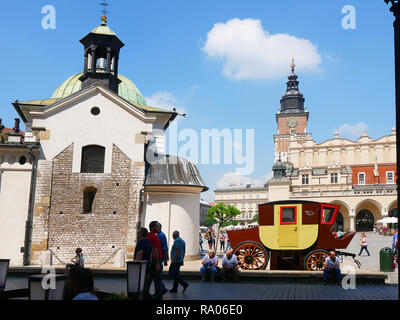 In Krakow Poland major landmarks include the Main Market Square with St. Mary`s Basilica and the Cloth Hall. The Old Post Coach is now a Post Office - Stock Photo