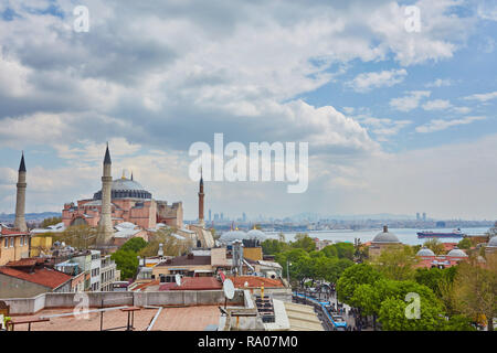Hagia Sophia in Istanbul. Basilica of Hagia Sophia is one of the best-known sights in Turkey. Hagia Sophia or Aya Sofya on the blue sky background. Sc - Stock Photo
