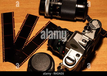 Naples , Italy  December 28 2018 : An old still working camera, his films to be developed, his telephoto lenses and wide-angles, his flash. - Stock Photo