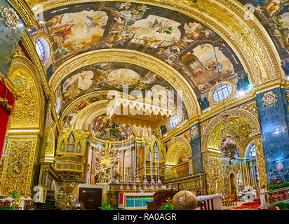 VALLETTA, MALTA - JUNE 18, 2018: The Sanctuary and High Altar of St John's Co-Cathedral with unique Baroque decorations of stone, gilded stucco, silve - Stock Photo