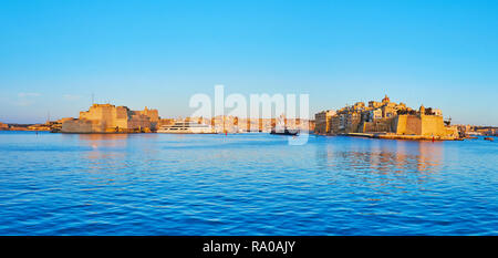 Enjoy the picturesque Valletta Grand Harbour with a view on fortified cities of Birgu and Senglea with Vittoriosa marina in the middle, Malta. - Stock Photo