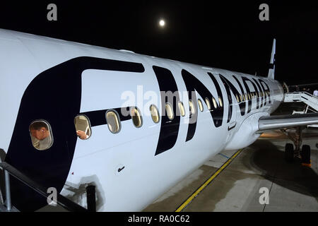 04.12.2017, Berlin, Berlin, Deutschland, Maschine der Fluggesellschaft Finnair auf dem Vorfeld des Flughafen Berlin-Tegel. 00S171204D025CARO.JPG [MODE - Stock Photo