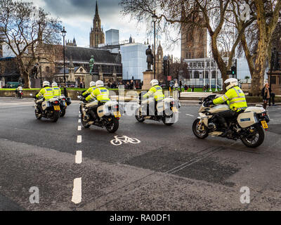 London Metropolitan Police Escort Motorcyclists - London Motorcycle Police outriders in Westminster Central London UK - Stock Photo
