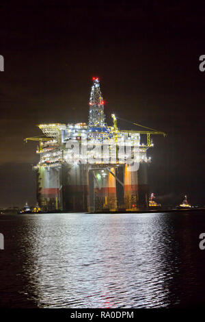'Big Foot'  Chevron's Deep Ocean Platform, extension leg platform, floating production facility, tugboats assisting. - Stock Photo
