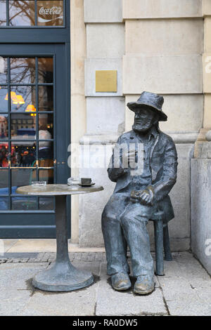 The Piotr Skrzynecki Monument, a tribute to the man that was an eccentric legend in the local arts scene, on Main Market Square, in Krakow, Poland - Stock Photo
