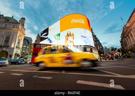 London black cab in Picadilly Circus at night - Stock Photo